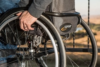 Man using a wheelchair, a close up of the back of his wheelchair
