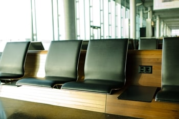 Modern black seats in a waiting lounge of an airport
